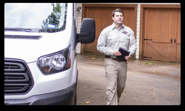austin tx pest control technician arriving for pest control treatment